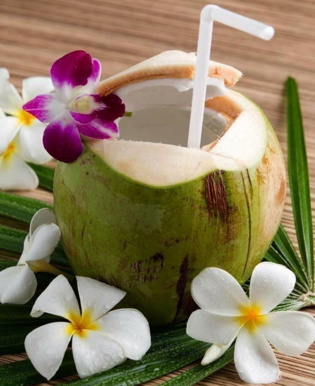 straw and flowers in coconut