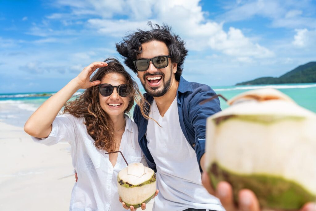 couple holding coconut